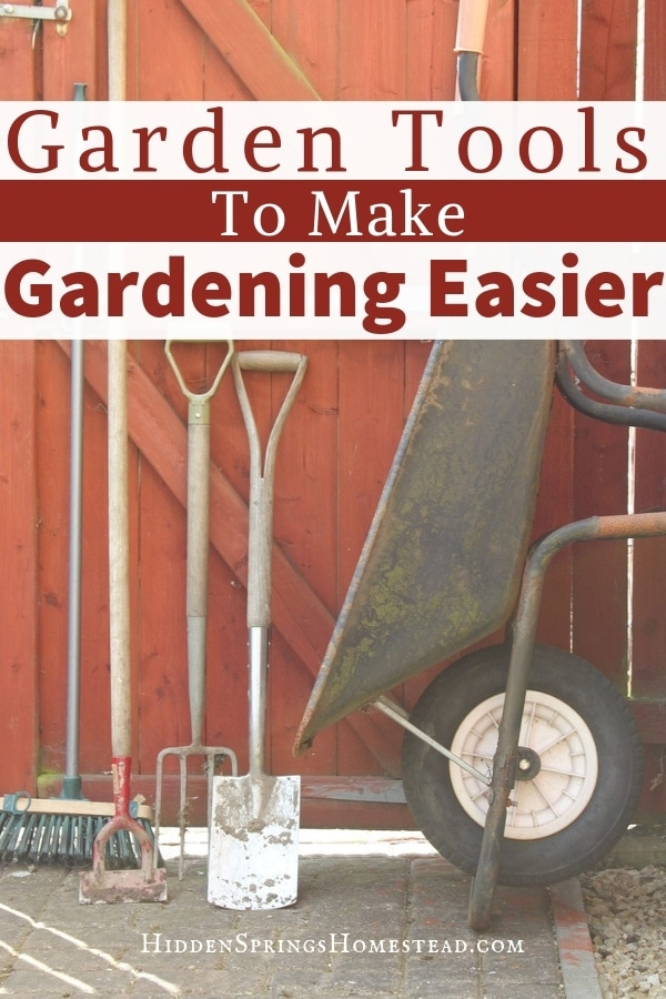 wheelbarrow, pitchfork, and other garden tools leaned up on a fence. Garden Tools You Need for Gardening. Hidden Springs Homestead