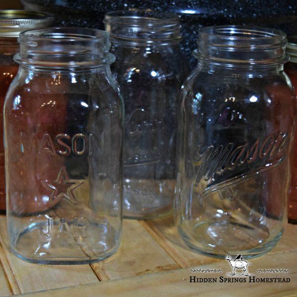 Mason canning jars sitting on a wood surface
